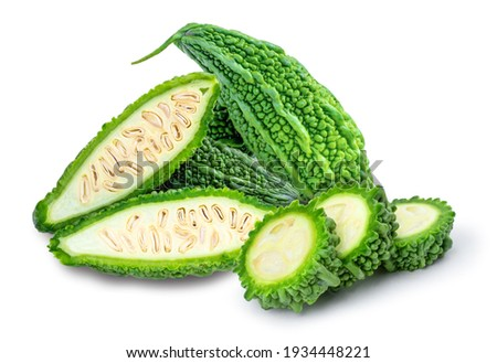 Closeup fresh bitter gourd ( bitter cucumber, Momordica Charantia or bitter melon ) with cut slice isolated on white background.