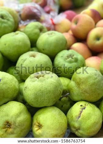 Closeup Freshly pears fruit is available for sale to customers in the supermarket,market.fresh fruits.Blurry apples background with depth of field camera effect.
