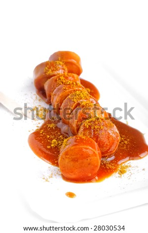 closeup from a curry sausage with ketchup