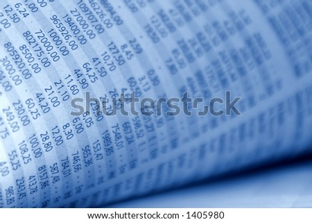 Closeup from stock quotes in a newspaper, in blue