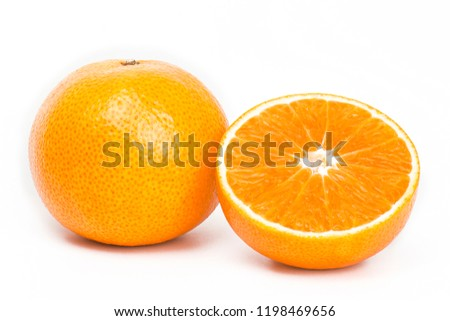 Closeup full and a half orange furit isolate on white background.