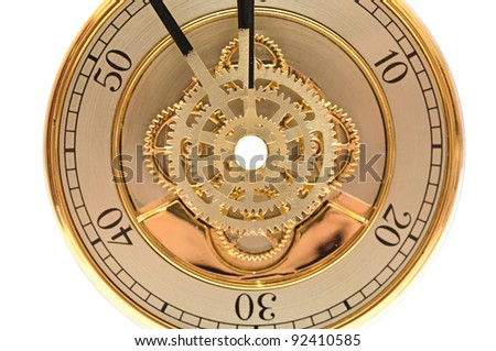closeup golden clock with gears on white