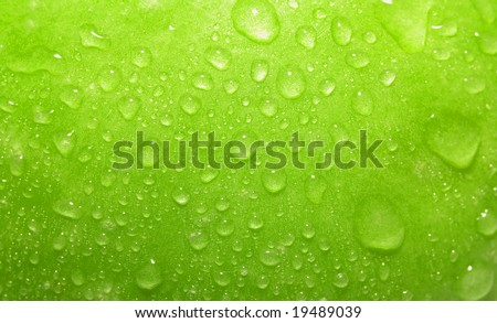 Closeup green apple with water-drops
