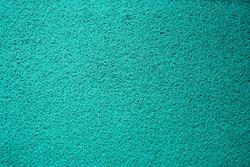 Closeup green turf plastic doormat or carpet texture