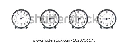 Closeup group of black and white clock for decoration show the time in 2 , 2:15 , 2:30 , 2:45 p.m. isolated on white background #1023756175
