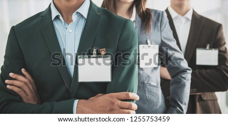 closeup.group of business people with blank badges #1255753459