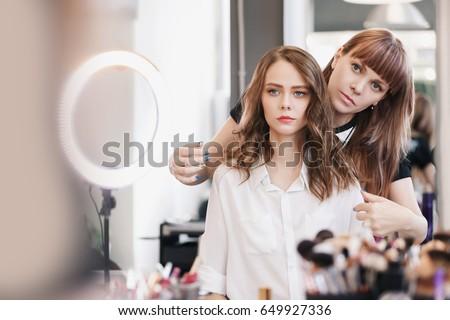 closeup hairdresser makes...