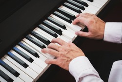 Closeup hand man playing piano. Classical music instrument. Fade color tone.