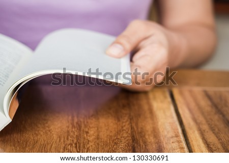 Closeup hand open book for reading concept background #130330691