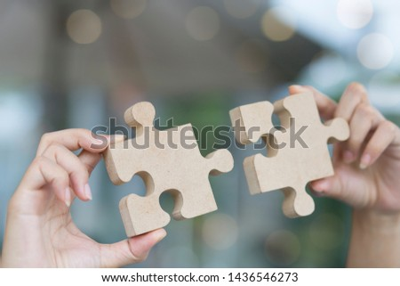 Closeup hand, woman connecting jigsaw puzzle Business solutions, target, success, goals and strategy concepts