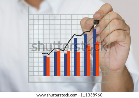 Closeup hand writing success graph