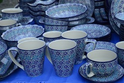 Closeup handmade pottery with blue pattern produced in Boleslawiec, Poland