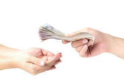 Closeup hands giving money isolated on white background