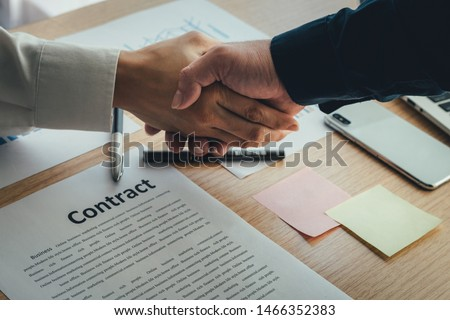 Photo of  closeup.handshake business partners agree to contract Real Estate Venture International trade,contract investment in meetings vision to invest for profit