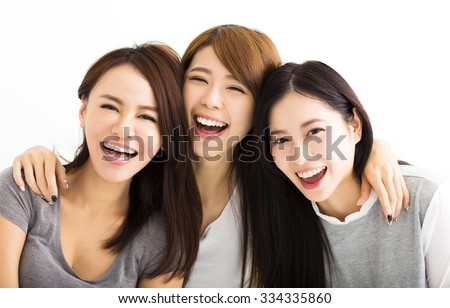Closeup happy Young Women Faces Looking at Camera #334335860