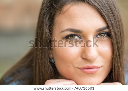 Closeup headshot of beautiful teenage smiling girl with blurred background. #740716501