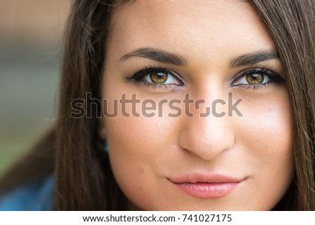 Closeup headshot of beautiful teenage smiling girl with blurred background. #741027175