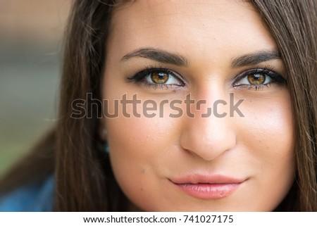 Closeup headshot of beautiful teenage smiling girl with blurred background. #741027175