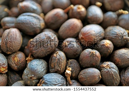 Closeup Heap of Dried Coffee Whole Beans with Shell