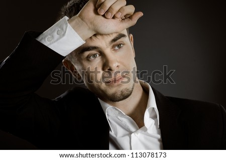 closeup horizontal portrait  the  beautiful  businessman in  costume without necktie