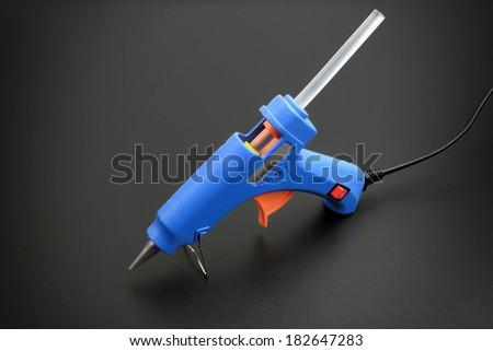 closeup hot glue gun with glue stick