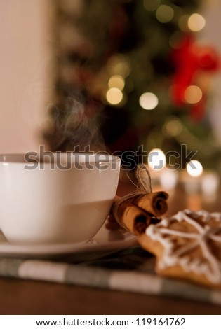 Closeup image cup of coffee with cinnamon and traditional christmas cookies - stock photo