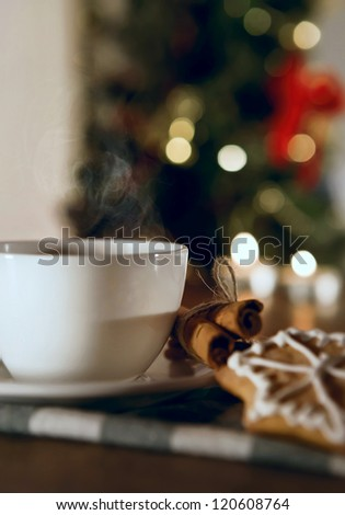 Closeup image cup of coffee with cinnamon and traditional christmas cookies