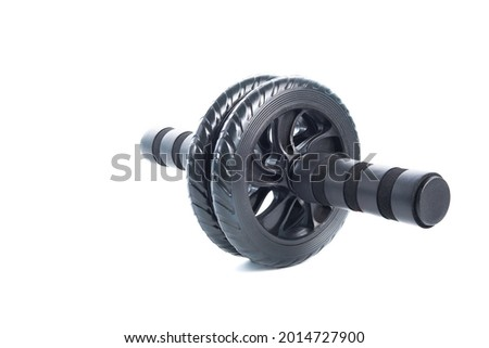 Closeup image o abdominal wheel isolated or  white background. Home fitness fitness wheel. Healthy lifestyle at quarantine, copy space for text. Foto stock ©