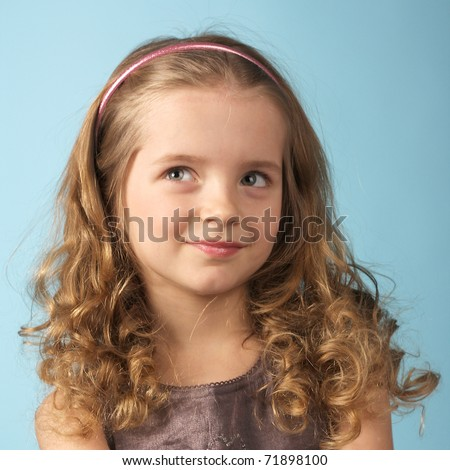 closeup image of a curly pretty little girl - stock photo