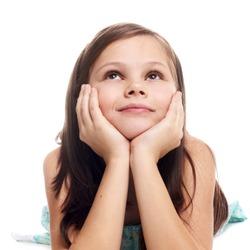 closeup image of a dreaming beautiful little girl