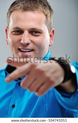 Closeup image of a man pointing forward