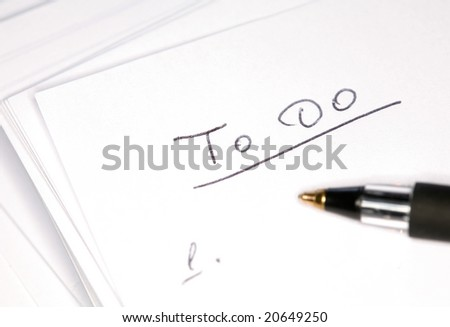 Closeup image of black pen on notebook