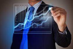 Closeup image of businessman drawing 3d graphics