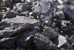 Closeup image of coal pieces. Background. Concept of heating, mining, miners