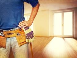 closeup image of handyman at home