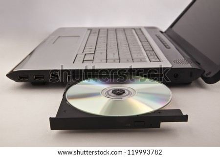 Closeup image of laptop with open DVDROM