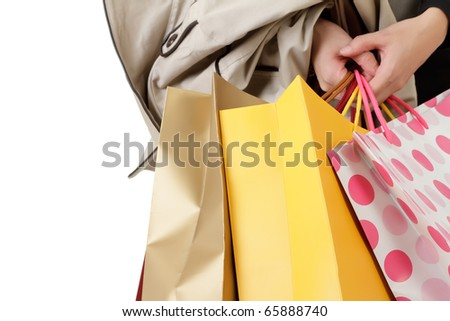 Closeup image of shopping woman holding bags.