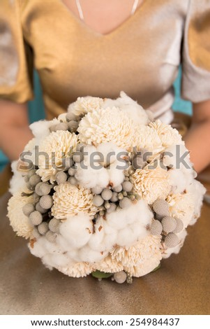 closeup image of stylish bridal bouquet. bridal bouquet of flowers from the bark of Sola, cotton and brunei