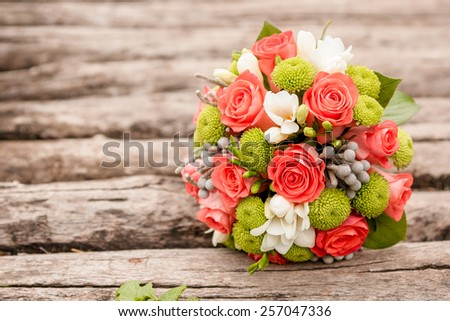 closeup image of stylish bridal bouquet on the green grass. bridal bouquet of flowers from the bark of Sola, cotton and brunei