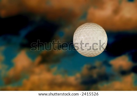 Closeup image of Suspended ball against the fall sky