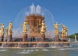 Closeup image of the beautiful golden soviet fountain: The Friendship of Peoples Fountain, Moscow, Russia. The fountain is one of the symbols not only of VDNH but also of Moscow. Friendship concept.