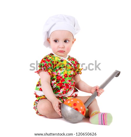 closeup image of the cute little girl in the cook cap