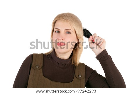 closeup image of the pretty blond woman combing
