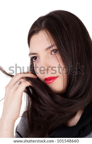 closeup image of the young beautiful girl with the luxuriant hair