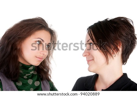 closeup image of the young pretty girls admiring one another