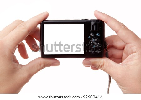 Closeup image of two hands holding black compact digital photo camera with empty display for your picture or text (copy space), isolated on white background