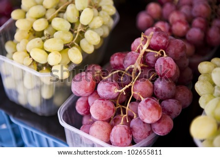 Closeup image of unwashed red and green grapes.