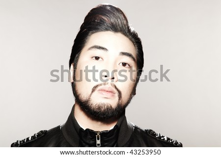 stock photo : Closeup image of young male model with hip hairstyle and