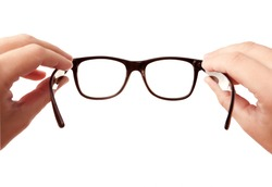 Closeup image: two hands holding black classic glasses while putting your eye-wear on, isolated on white background, may use as copy space for your text or object