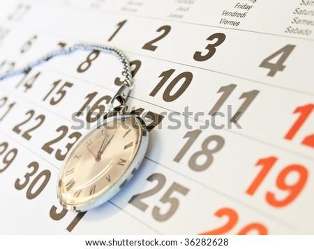 Closeup сlock and  calendar - stock photo